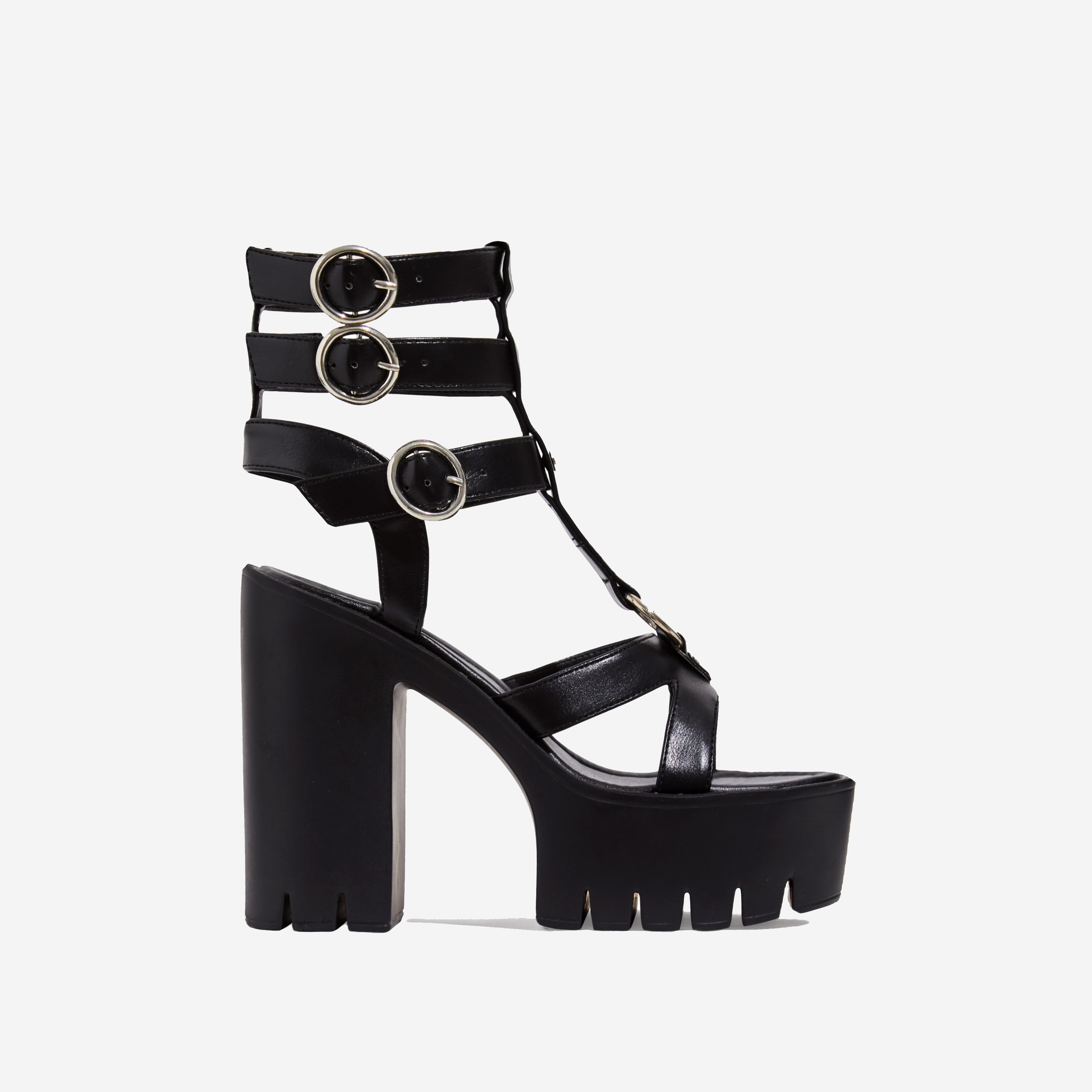 Leap Platform Cut Out Caged Heel In Black Faux Leather