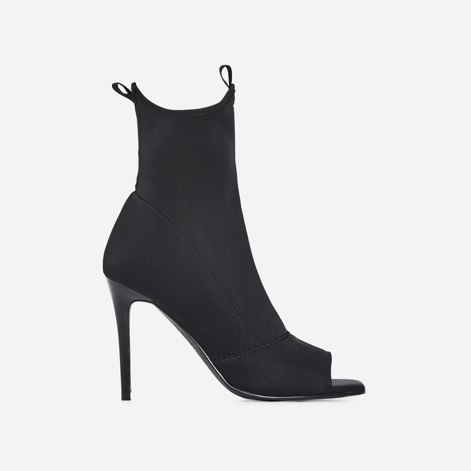 Carter Peep Toe Ankle Sock Boot In Black Lycra