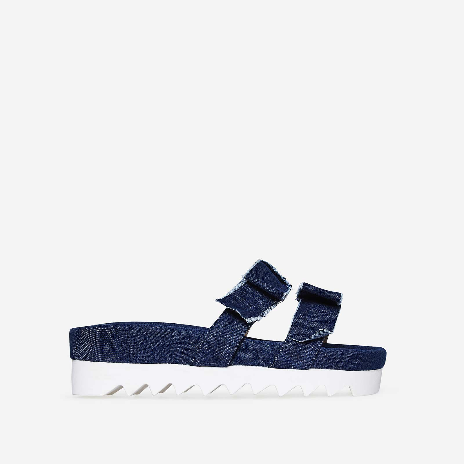 Elie Bow Slider In Dark Blue Denim