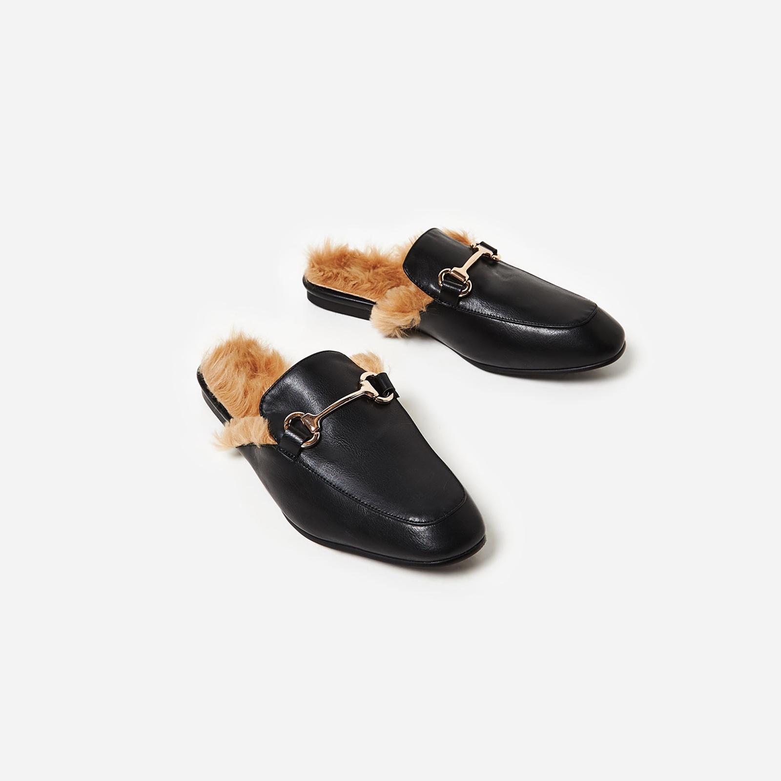 Leona Faux Fur Lined Flat Mule In Black Faux Leather Image 1