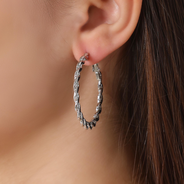 Twisted Hoop Earrings In Silver