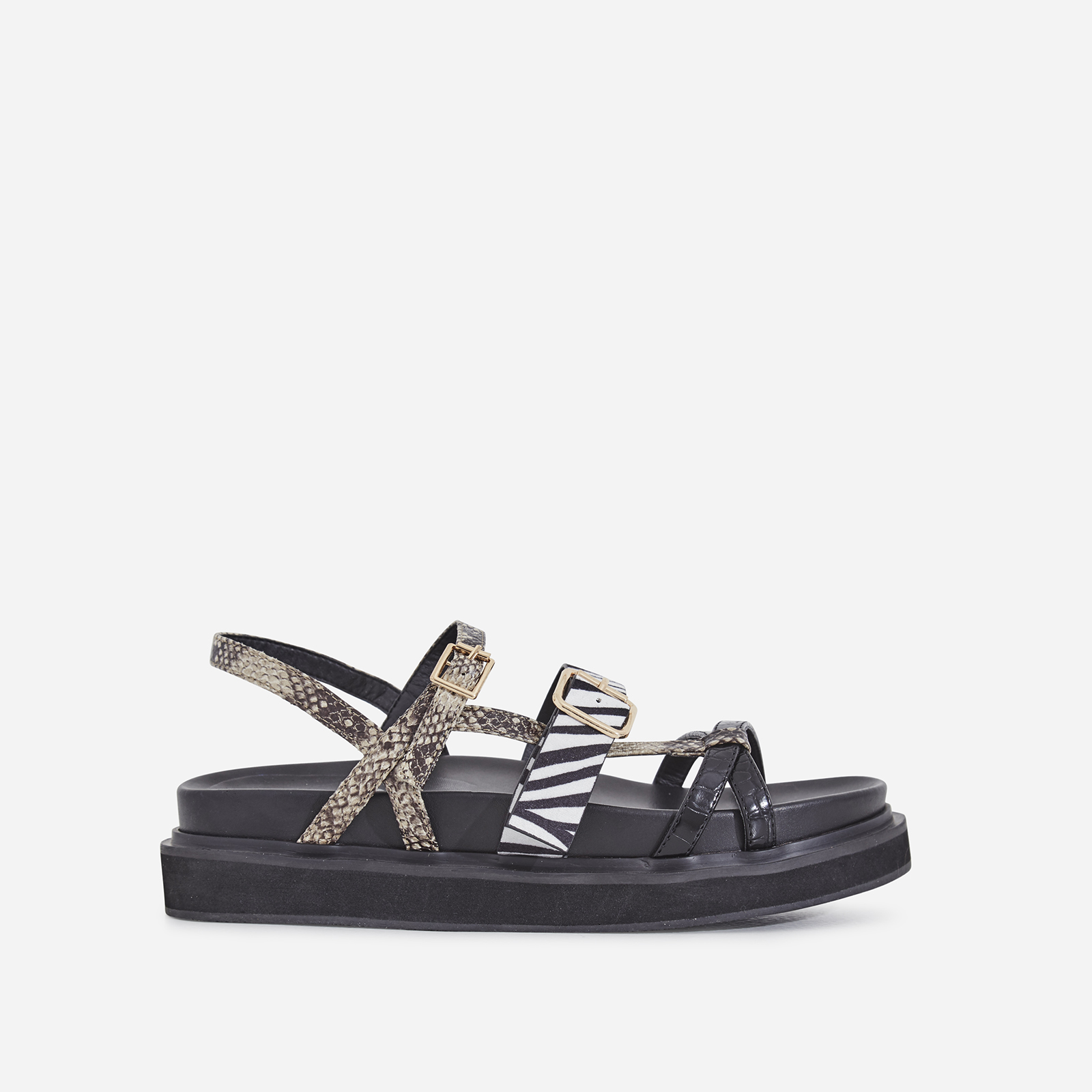 Andro Chunky Sole Sandal In Mixed Animal Print