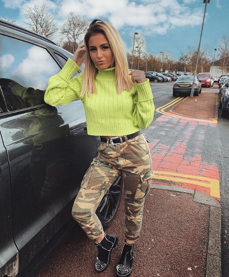 camo trousers biker boots outfit